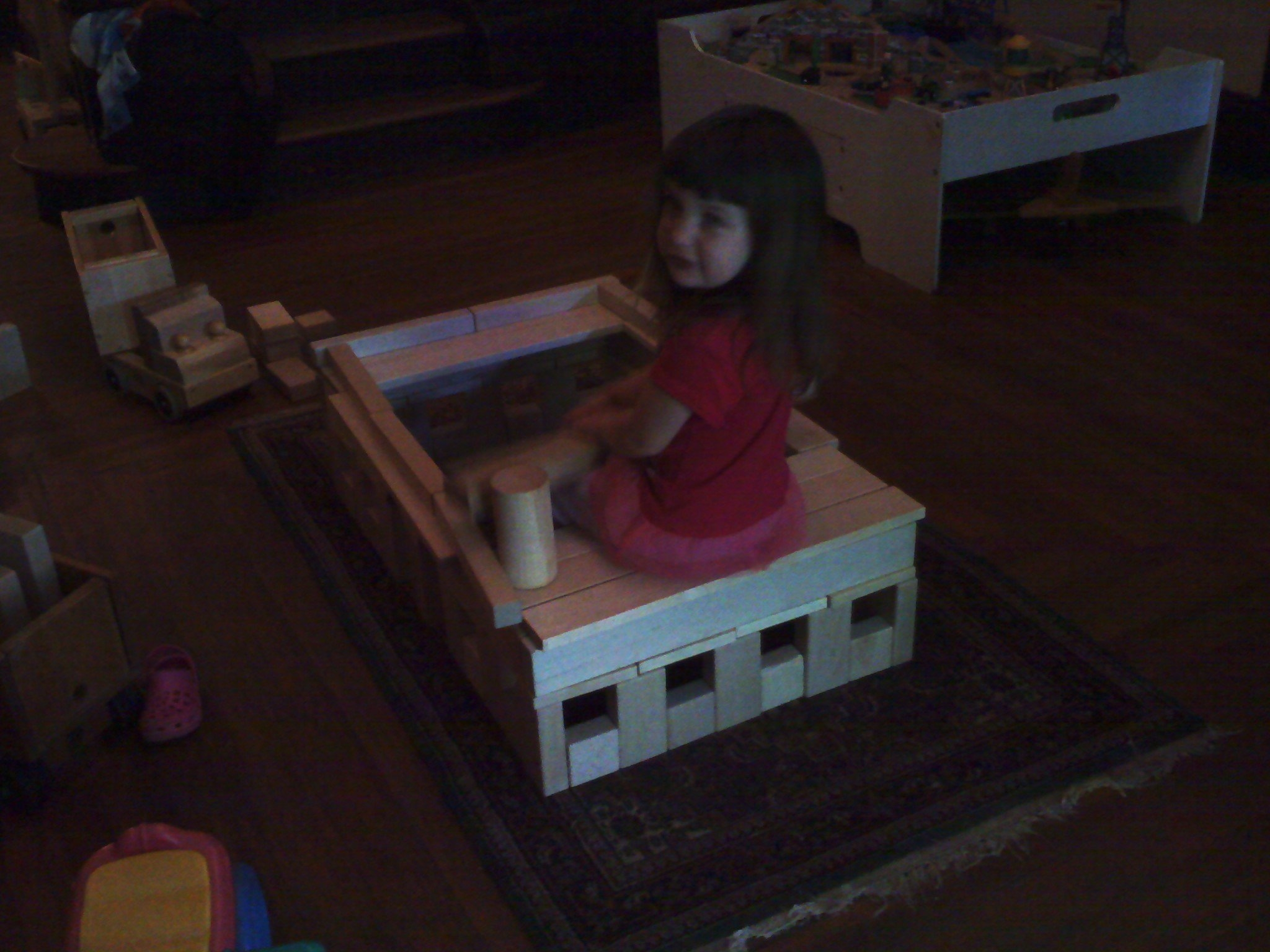 Photo of Livea playing with her hospital made from a CP61 Quarter Classroom Set of Hard Rock Maple Wooden Unit Blocks.